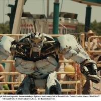 "Photo -  ""REAL STEEL""  RS-FF-020  Charlie Kenton  (Hugh Jackman) operates Ambush during a fight at a local county fair in DreamWorks Pictures' action drama ""Real Steel"".  ©DreamWorks II Distribution Co., LLC.  All Rights Reserved."