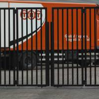 Photo - FILE - In this Feb. 21, 2012 file photo a TNT delivery truck is seen behind a closed gate in Hoofddorp, near Amsterdam, Netherlands. United Parcel Service Inc. has ditched its euro5.2 billion (US$6.9 billion) takeover of TNT Express NV after learning that European regulators would reject the deal in its current form. (AP Photo/Peter Dejong, File)