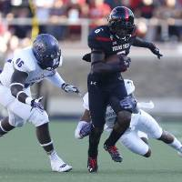 Photo - Texas Tech's Devin Lauderdale (6) tries to get past Central Arkansas' Bobby Watkins (7) and D.J. Holland (46) during an NCAA college football game in Lubbock, Texas, Saturday, Aug. 30, 2014. (AP Photo/Lubbock Avalanche-Journal, Tori Eichberger) ALL LOCAL TELEVISION OUT