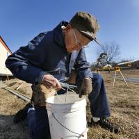 Photo -  Gerald Vincent, 87, iof Duncan, nstalls skirting on a mobile home in Little Axe. The Nail Benders group from First Baptist Church of Duncan helped repair a mobile home damaged after the May 2013 tornadoes.  STEVE SISNEY - THE OKLAHOMAN