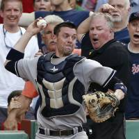 Photo - New York Yankees catcher Chris Stewart, center, throws to second base for the double play after fielding a pop foul by Boston Red Sox's Dustin Pedroia in the eighth inning of a baseball game in Boston, Saturday, July 20, 2013. (AP Photo/Michael Dwyer)
