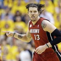 Photo - FILE - In this June 1, 2013, file photo, Miami Heat shooting guard Mike Miller reacts to play against the Indiana Pacers during the second half of Game 6 of the NBA Eastern Conference basketball finals in Indianapolis. The Heat are designating Miller as their amnesty player, a move that may save more than $30 million in luxury tax payments over the next two years. Miller tells The Associated Press he understands the move, though he's disappointed to leave a championship club. (AP Photo/Michael Conroy, File) ORG XMIT: NY161