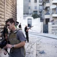 Photo - FILE - This September 2012 file photo posted on the website freejamesfoley.org shows journalist James Foley in Aleppo, Syria.In a horrifying act of revenge for U.S. airstrikes in northern Iraq, militants with the Islamic State extremist group have beheaded Foley — and are threatening to kill another hostage, U.S. officials say. (AP Photo/freejamesfoley.org, Manu Brabo, File) NO SALES