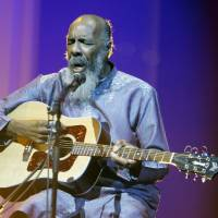 Photo - FILE - In this May 1, 2008 file photo, Richie Havens plays at the opening night ceremony during the 61st International film festival in Cannes, southern France. Havens, who sang and strummed for a sea of people at Woodstock, has died at 72. His family says in a statement that Havens died Monday, April 22, 2013, of a heart attack. (AP Photo/Jeff Christensen, file)