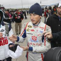 Photo -   Driver Kasey Kahne signs autographs before practice for the Sunday's NASCAR Sprint Cup Series auto race at Kansas Speedway in Kansas City, Kan., Friday, Oct. 19, 2012. (AP Photo/Colin E. Braley)