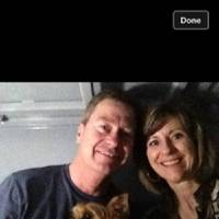 Photo - Jeff and Cindy Smith posted this snapshot of themselves with Jazzy, their Yorkshire terrier, in their storm shelter on Facebook last Sunday to let family and friends know they were safe from the severe weather. PROVIDED BY JEFF SMITH