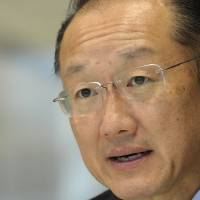 Photo - World Bank President Jim Kim speaks during an interview with The Associated Press at the World Bank in Washington, Tuesday, Sept. 3, 2013. He says his staff is doing a rush assessment of the impact of the Syrian conflict on Lebanon to prepare the ground for a new wave of international aid. (AP Photo/Susan Walsh)