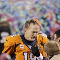 Photo - Denver Broncos' Peyton Manning walks off the field after the NFL Super Bowl XLVIII football game against the Seattle Seahawks Sunday, Feb. 2, 2014, in East Rutherford, N.J. The Seahawks won 43-8. (AP Photo/Chris O'Meara)
