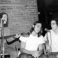 Photo - Phil Moss, from left, Brian Howell and Chuck Adams perform at a college in Illinois in 1971. PHOTO PROVIDED,