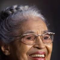 Photo - FILE -- In a June 15, 1999 file photo Rosa Parks smiles during a Capitol Hill ceremony where  Parks was honored with the Congressional Gold Medal in Washington.   Parks will become the first black woman to be honored with a full-length statue in the Capitol's Statuary Hall on Wednesday Feb. 27, 2013.   (AP Photo/Khue Bui)