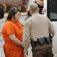 Photo - Kimberly Crain arrives at the Pottawatomie County Courthouse on Wednesday morning.   Photo by Jim Beckel, The Oklahoman