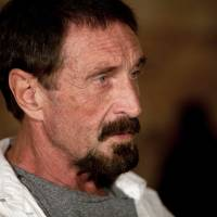 Photo - Software company founder John McAfee listens to a question during an interview at a local restaurant in Guatemala City, Tuesday, Dec. 4, 2012.  McAfee, 67, has been identified as a