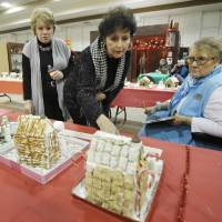 Photo - Beth Kerr, left, Carol Smaglinski, center, and Dot Norman judge the fourth annual gingerbread house contest at the Edmond Historical Society and Museum. PHOTOS BY PAUL HELLSTERN, THE OKLAHOMAN