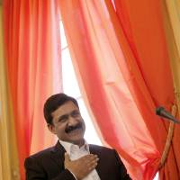 Photo - Ziauddin Yousufzai gestures before receiving, on behalf of his daughter Malala Yousufzai, the Simone de Beauvoir Prize for Women's Freedom, in Paris, Wednesday, Jan. 9, 2013. Malala Yousafzai, who is currently living in the UK, was the victim of an assassination attempt in October last year because of her determined commitment to the right to education. (AP Photo/Christophe Ena)