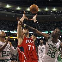 Photo -   Boston Celtics' Mickael Pietrus (28) blocks Atlanta Hawks' Vladimir Radmanovic (77) as Celtics' Ray Allen (20) watches the ball during Game 3 of an NBA first-round playoff basketball series, Friday, May 4, 2012, in Boston. The Celtics defeated the Hawks 90-84, leading the series 2-1. (AP Photo/Charles Krupa)