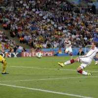 Photo - Germany's Mario Goetze kicks to score his side's first goal in extra time against Argentina's goalkeeper Sergio Romero during the World Cup final soccer match between Germany and Argentina at the Maracana Stadium in Rio de Janeiro, Brazil, Sunday, July 13, 2014. (AP Photo/Felipe Dana)