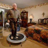 Photo - Bob Sonnenfeld  is a 92-year-old WWII veteran who has lived an active life. He attributes his long life to getting plenty of exercise. Part of Sonnenfeld's morning workout includes jogging on a trampoline in his bedroom.  Jim Beckel - THE OKLAHOMAN