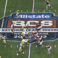 Photo -   FILE - In this Jan. 9, 2012, file photo, Alabama, right, prepares to snap the ball against LSU during the first half of the BCS National Championship college football game in New Orleans. College football has taken a big step toward having a final four. BCS Executive Director Bill Hancock said, Thursday, April, 26, 2012, that conference commissioners will present a