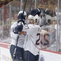 Photo - Oklahoma City's Martin Marincin, left, and Taylor Fedun celebrate after Fedun scored in the second period of Thursday's game against Texas.  PHOTO BY STEVEN CHRISTY, OKLAHOMA CITY BARONS