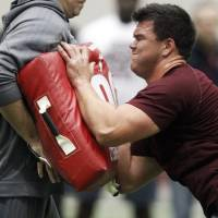 Photo - Texas A&M offensive tackle Jake Matthews competes during Texas A&M's pro day held Wednesday, March 5, 2014, in College Station, Texas.  (AP Photo/Patric Schneider)