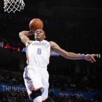 Photo - Oklahoma City's Russell Westbrook (0) slam dunks the ball in the first quarter during the NBA basketball game between the Oklahoma City Thunder and the Houston Rockets at Chesapeake Energy Arena in Oklahoma City, Friday, Jan. 6, 2012. Photo by Nate Billings, The Oklahoman
