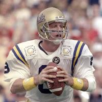 Photo - FILE - In this Jan. 3, 1989, file photo, UCLA quarterback Troy Aikman looks for a receiver during action in the Cotton Bowl football game, in Dallas. Aikman is being enshrined into the College Football Hall of Fame on Saturday, July 18, 2009. (AP Photo/Lou Krasky, File) ORG XMIT: NY156