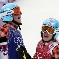 Photo - Canada's Marielle Thompson, left, celebrates after winning the gold medal ahead of silver medalist and compatriot Kelsey Serwa, right, in the women's ski cross final at the Rosa Khutor Extreme Park, at the 2014 Winter Olympics, Friday, Feb. 21, 2014, in Krasnaya Polyana, Russia. (AP Photo/Andy Wong)