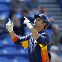Photo - Houston Astros' Carlos Pena celebrates after hitting a 2-run home run during the fourth inning of an exhibition spring training baseball game against the New York Mets Saturday, March 9, 2013, in Port St. Lucie, Fla. (AP Photo/Jeff Roberson)