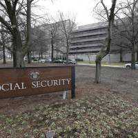 Photo - FILE - This Jan. 11, 2013 file photo shows the Social Security Administration's main campus in Woodlawn, Md. Just like other married couples, same-sex couples are about to find out that federal benefits for being married might not be all they're cracked up to be.  Social Security benefits for spouses can be generous, but only for couples with big disparities in their incomes. Taxes are a decidedly mixed bag, and there still a lot of unanswered questions for the Internal Revenue to address.  (AP Photo/Patrick Semansky, File)
