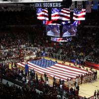 Photo - A giant American Flag is unfurled during the pre-game ceremonies as the University of Oklahoma Sooners (OU) men play the Iowa State Cyclones in NCAA, college basketball at Lloyd Noble Center on Saturday, March 2, 2013  in Norman, Okla. Photo by Steve Sisney, The Oklahoman