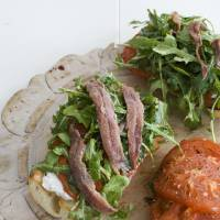 Photo - An open-faced anchovy sandwich with balsamic arugula.  Matthew Mead - AP