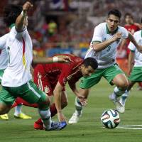 Photo - Spain's Pedro Rodriguez, second left, vies for the ball as Bolivia's Damir Miranda, right, and Luis Gutierrez, second right, looks on during their friendly soccer match in Seville, on Friday, May 30. 2014. (AP Photo/Miguel Angel Morenatti)