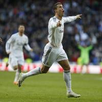 Photo - Real Madrid's Cristiano Ronaldo, right, celebrates his goal during a Spanish La Liga soccer match between Real Madrid and Granada at the Santiago Bernabeu stadium in Madrid, Spain, Saturday, Jan. 25, 2014. (AP Photo/Andres Kudacki)