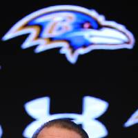 Photo - Baltimore Raven's owner Steve Bisciotti smiles as he answers questions from the media during a news conference Wednesday, Jan 8, 2014 in Owings Mills, Md.(AP Photo/Gail Burton)