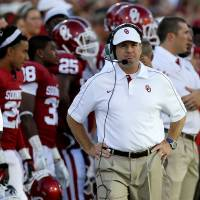 Photo - Oklahoma coach Bob Stoops paces the sidelines during the college football game between the University of Oklahoma Sooners (OU) and Florida A&M Rattlers at Gaylord Family-Oklahoma Memorial Stadium in Norman, Okla., Saturday, Sept. 8, 2012. Photo by Bryan Terry, The Oklahoman