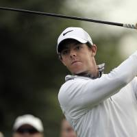 Photo - Rory McIlroy of Northern Ireland follows his ball on the 14t hole during the first round of the Dubai Desert Classic golf tournament in Dubai, United Arab Emirates, Thursday, Jan. 30, 2014. (AP Photo/Kamran Jebreili)