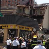 Photo - Emergency personnel respond to a building collapse in downtown Philadelphia, where the city fire commissioner says as many as eight to 10 people are believed trapped in the rubble, Wednesday, June 5, 2013. (AP Photo/Jacqueline Larma)