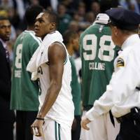 Photo - Boston Celtics' Rajon Rondo, center, walks off the court after being ejected in the second quarter of an NBA basketball game against the Brooklyn Nets in Boston, Wednesday, Nov. 28, 2012. (AP Photo/Michael Dwyer)