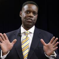 Photo - FILE - In this March 14, 2013 file photo, Washington-based attorney Kevyn Orr speaks at a news conference in Detroit.  Orr starts work Monday, March 25, 2013, as Detroit's emergency manager and the turnaround expert says his first tasks will be reviewing the city's financial data and listening. (AP Photo/Paul Sancya, File)