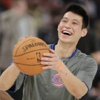 Photo -   FILE - This Feb. 24, 2012 file photo shows New York Knicks' Jeremy Lin laughing during warmups before the start of the NBA All-Star Rising Stars Challenge basketball game in Orlando, Fla. This would have been such an easy decision in February. Lin was the biggest thing in basketball, and no way the Knicks would have let him go elsewhere. Now, knowing his price and with no assurance he'll play as he did when Linsanity reigned, the Knicks may allow Lin to leave for Houston. (AP Photo/Chris O'Meara, File)