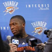 Photo - Oklahoma City's Nate Robinson talks to the media at the the Thunder practice facility, Saturday, Feb, 26, 2011, in Oklahoma City.Photo by Sarah Phipps, The Oklahoman