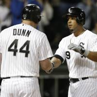 Photo - Chicago White Sox's Jose Abreu, right, celebrates with Adam Dunn after hitting a solo home run during the second inning of a baseball game against the Cleveland Indians in Chicago, Thursday, April 10, 2014. (AP Photo/Nam Y. Huh)