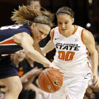 Photo - Pepperdine's Katie Menton (23) goes for the ball beside OSU's Lakyn Garrison (00) during a first-round NIT women's college basketball game between Oklahoma State University (OSU) and Pepperdine at Gallagher-Iba Arena in Stillwater, Okla., Wednesday, March 16, 2011. Photo by Bryan Terry, The Oklahoman