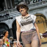 Photo -   British designer Vivienne Westwood receives applause during London Fashion Week, Sunday, Sept. 16, 2012. (AP Photo/Jonathan Short)