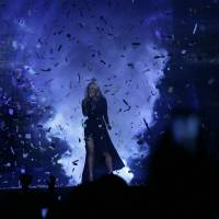 Photo - Carrie Underwood sings during the opening weekend of her
