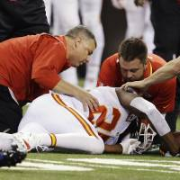 Photo - Kansas City Chiefs running back Jamaal Charles (25) is looked at by trainers after going down against the Indianapolis Colts during the first half of an NFL wild-card playoff football game Saturday, Jan. 4, 2014, in Indianapolis. (AP Photo/Darron Cummings)