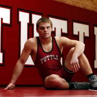 Photo - Tuttle wrestler Zachary Beard poses in the high school wrestling room on Wednesday, Feb. 20, 2013 in Tuttle , Okla.  He is the highest ranked Oklahoma wrestler nationally and will likely win his fourth state wrestling championship this weekend.   Photo by Steve Sisney, The Oklahoman