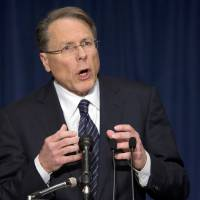 Photo - The National Rifle Association executive vice president Wayne LaPierre, gestures during a news conference in response to the Connecticut school shooting on Friday, Dec. 21, 2012 in Washington.  The nation's largest gun-rights lobby is calling for armed police officers to be posted in every American school to stop the next killer