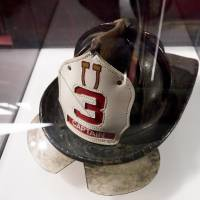 Photo -  A helmet New York City Fire Department Capt. Patrick John Brown wore on Sept. 11, 2001, is shown on display during a press preview of the September 11 memorial in New York. AP Photo   James Keivom