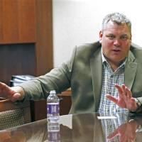 Photo - In this May 12, 2014 photograph, Scott Barber, Caesars regional president for the Mid-South, discusses the closing of Harrah's Tunica casino, in his office at the Robinsonville, Miss., gaming facility. The closure affects a work force of about 1,300 and involves several hotels, a golf course, a convention center and the casino itself. Caesars Entertainment Corp., will continue to operate its two other area properties: Horseshoe Tunica and Tunica Roadhouse Hotel and Casino. (AP Photo/Rogelio V. Solis)